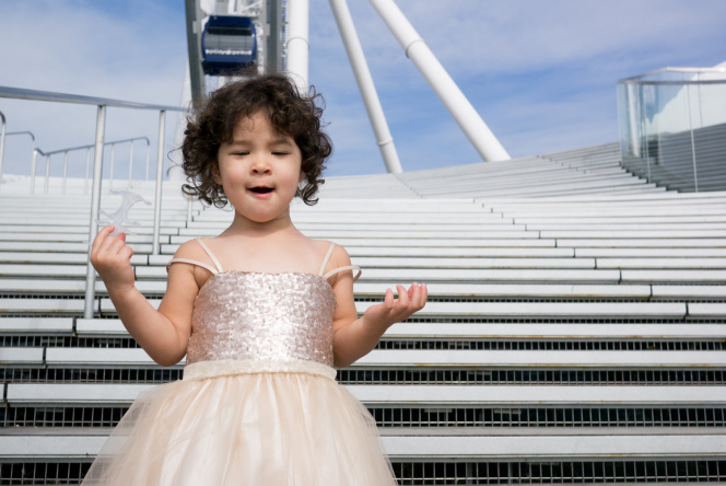 Maia singing in front of Navy Pier Wheels. Photo credit to Amie Kuo.